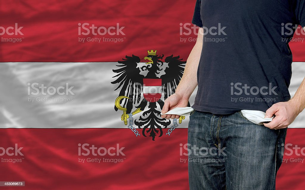poor man showing empty pockets in front of austria flag