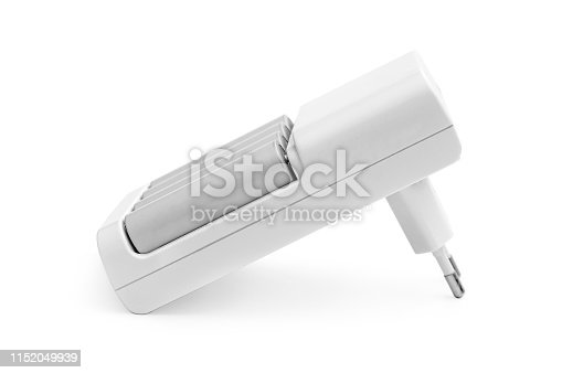 istock Rechargeable batteries in the charger on white. 1152049939