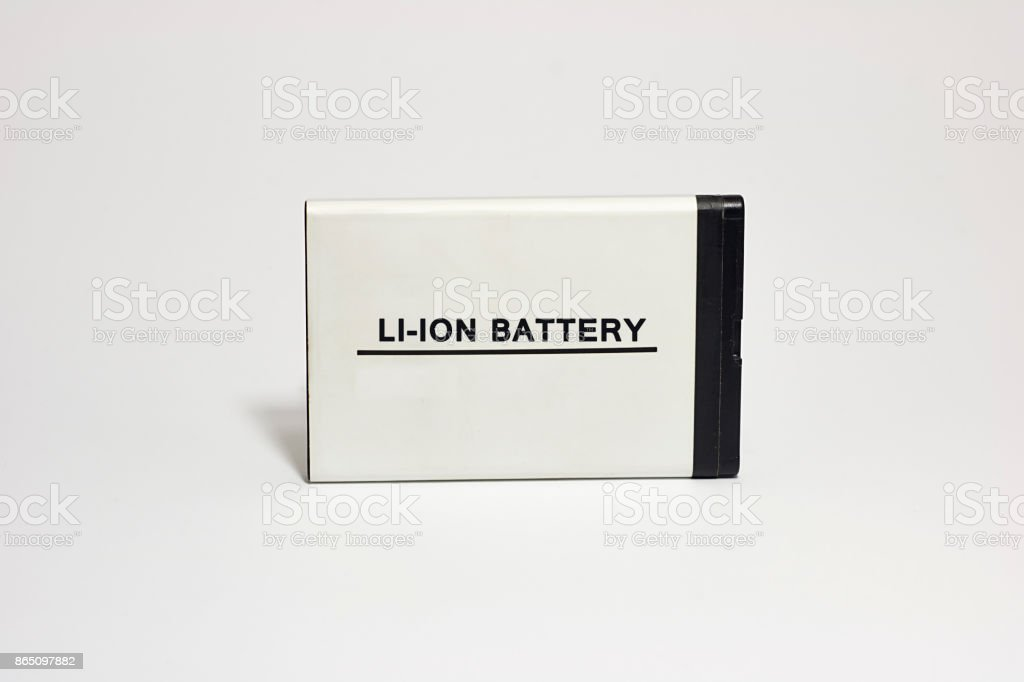 Rechargeable cell phone battery. Isolated on white background stock photo