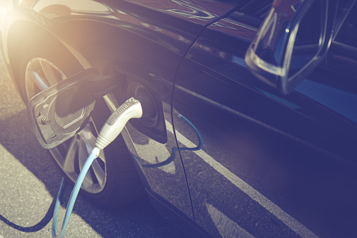 Recharging electric car by power cable.