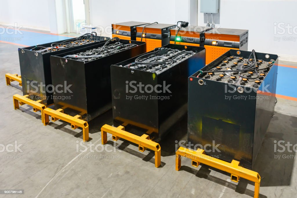 recharging electrical for forklift, battery charger. stock photo