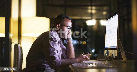 Shot of a handsome young businessman fast asleep at his desk during a late shift at the office