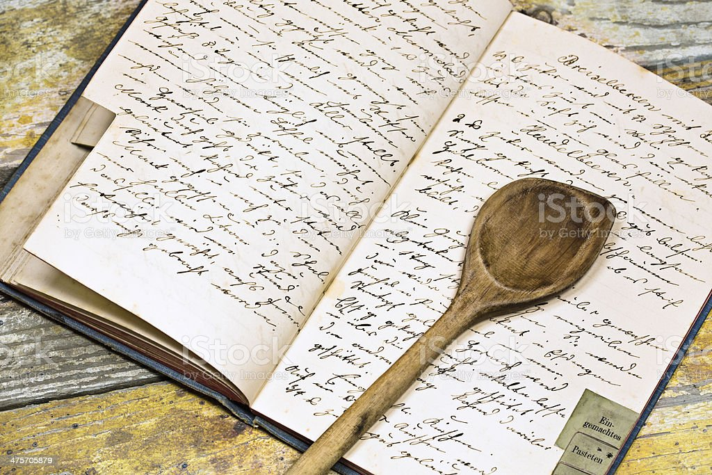 Recipe book with wooden spoon stock photo