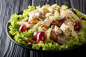 istock Recipe for delicious Sonoma salad with chicken breast, celery, pecans and grapes covered with sauce close-up. horizontal 1166230855
