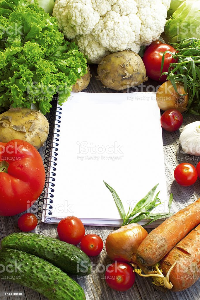 Recipe notebook and fresh vegetable royalty-free stock photo