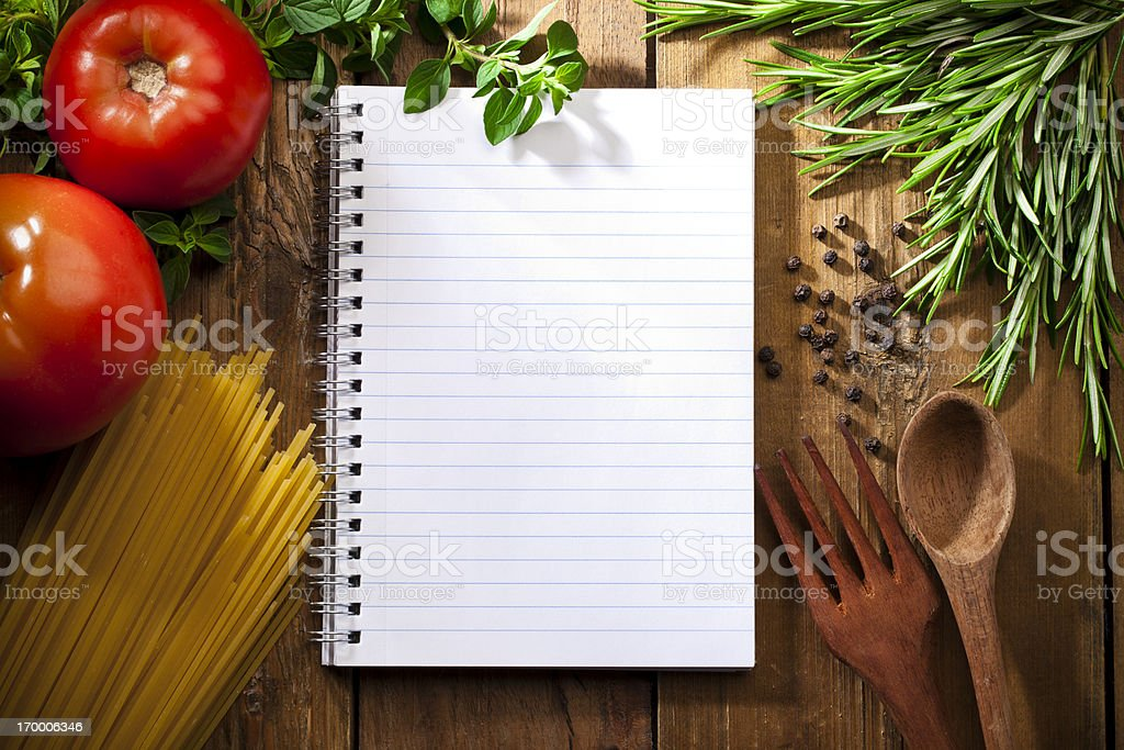 Recipe notepad surrounded by italian ingredients stock photo