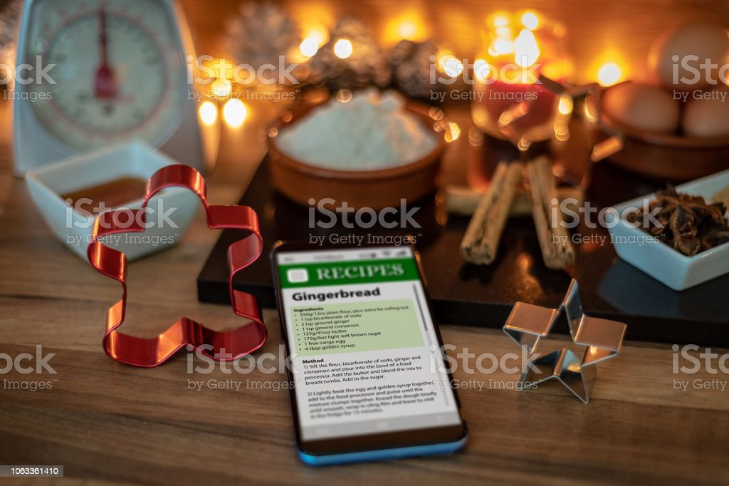 Recipe on a smartphone to make gingerbread stock photo