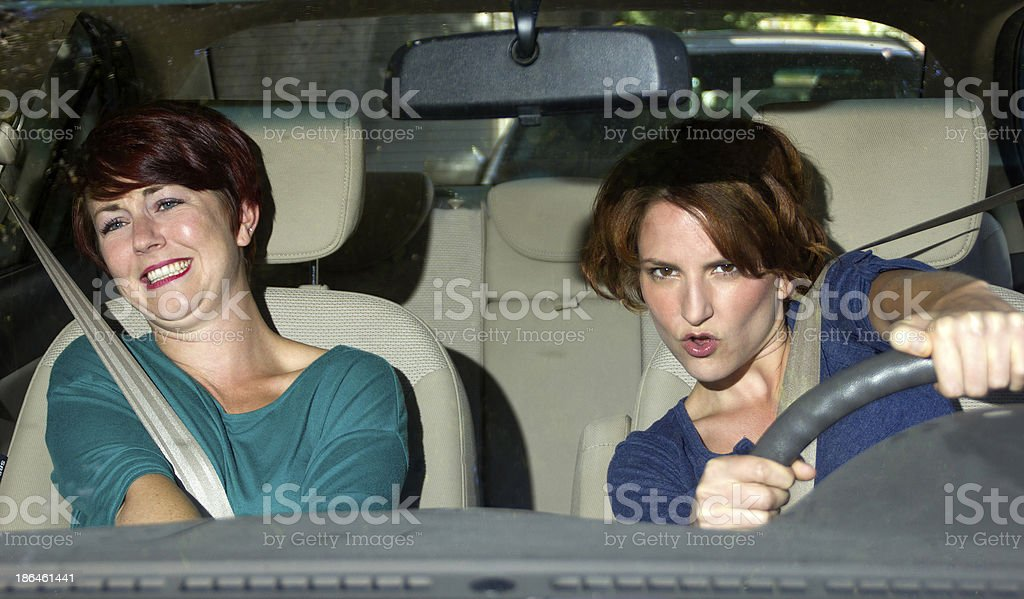 Reckless Driver with a Scared Passenger in the Car royalty-free stock photo