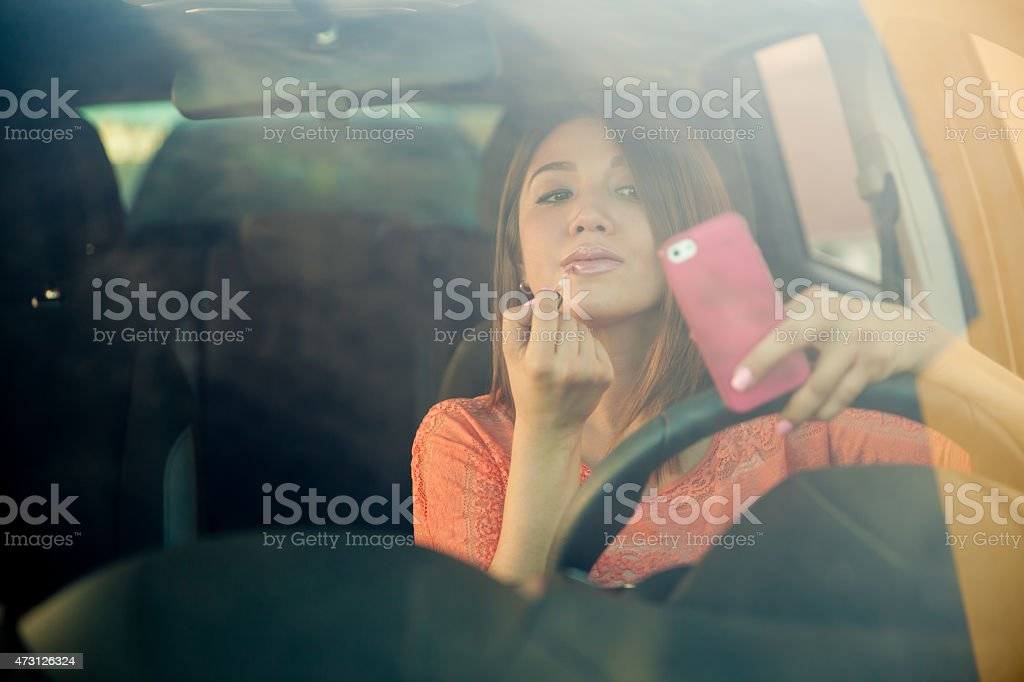 Reckless girl behind the wheel stock photo