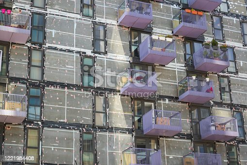 Re-cladding work in progress on a block of flats in Stratford, London, England