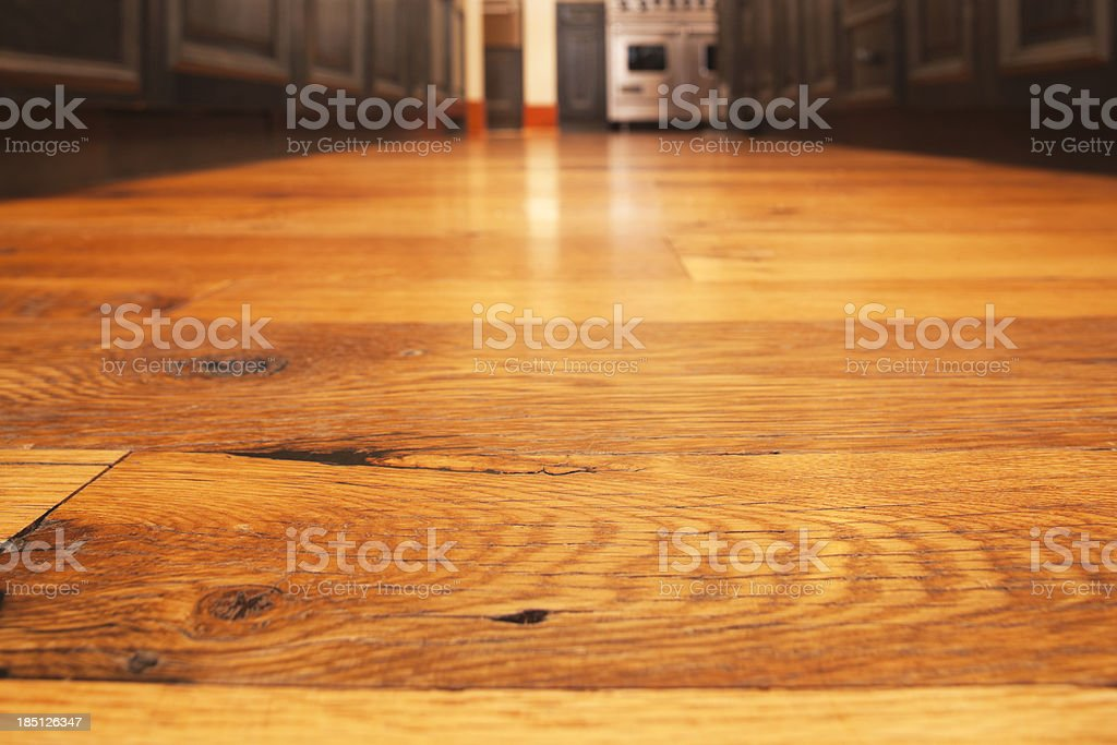 Reclaimed hardwood timber floor in kitchen. royalty-free stock photo