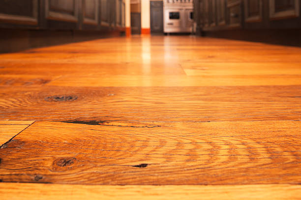 Reclaimed hardwood timber floor in kitchen. Reclaimed hardwood timber floor in a residential kitchen. Focus on the foreground.See more of my kitchen and home related images: half timbered stock pictures, royalty-free photos & images