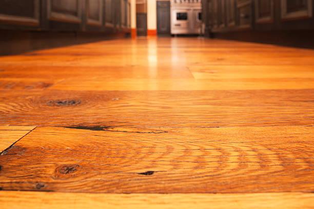 Reclaimed hardwood timber floor in kitchen. stock photo