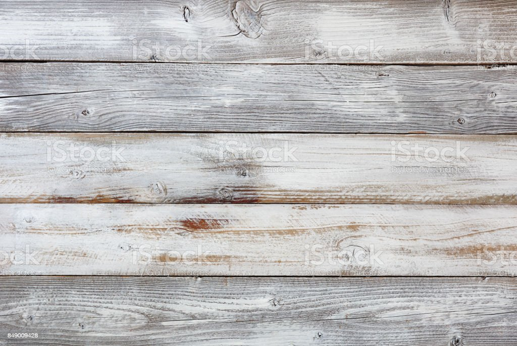 Reclaimed weathered white painted wooden boards stock photo