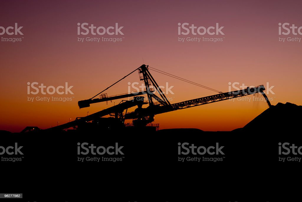 Reclaimer against the sunset on a Iron Ore Mine Site stock photo