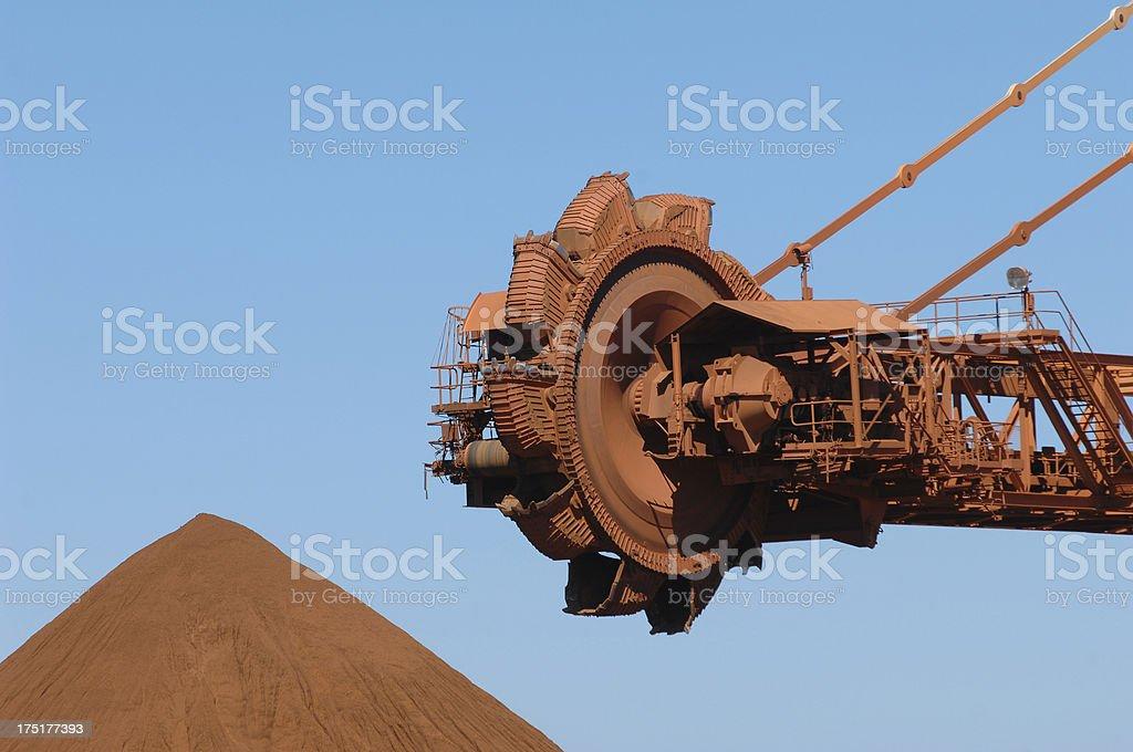 Reclaimer and Iron Ore Stockpile stock photo