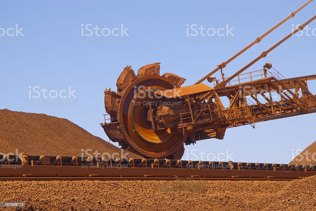 reclaimer on iron ore site royalty-free stock photo