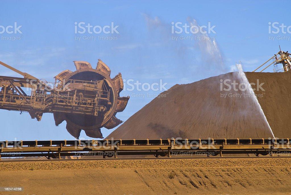Reclaimer Stockpile and dust suppression on Iron Ore Mine Site stock photo