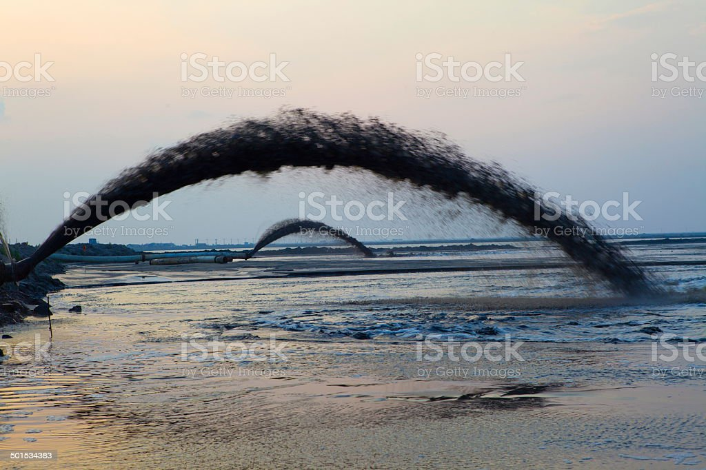 Reclamation for port purposes of land by dredging. stock photo