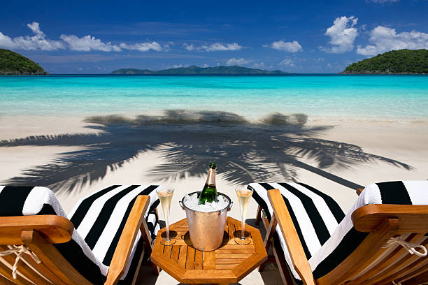 recliners with champagne at a tropical Caribbean beach