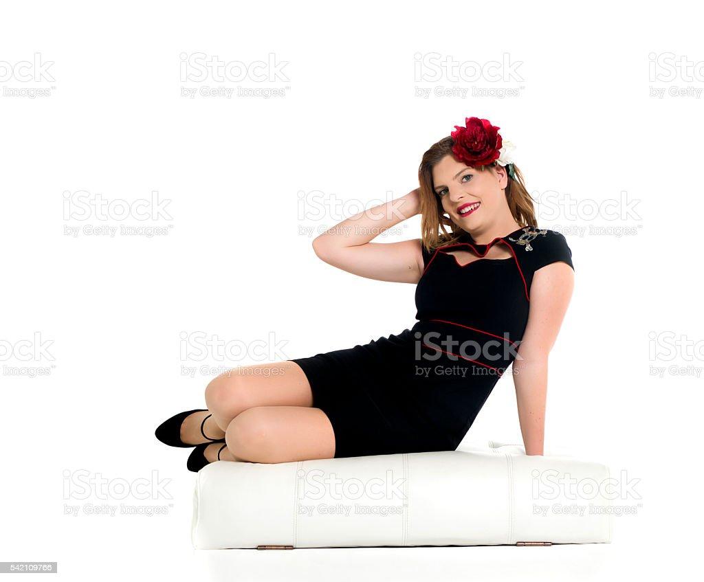 reclining black dress stock photo