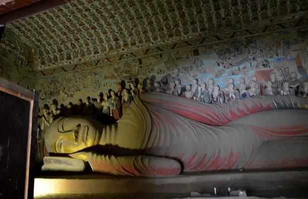 Reclining Buddha at Mogao Caves, Dunhuang, Gansu, China stock photo