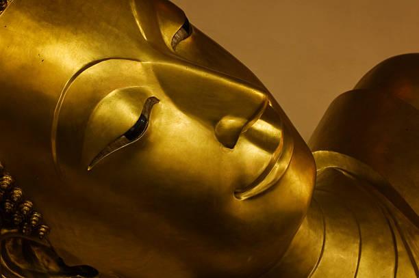 Reclining Buddha Face stock photo