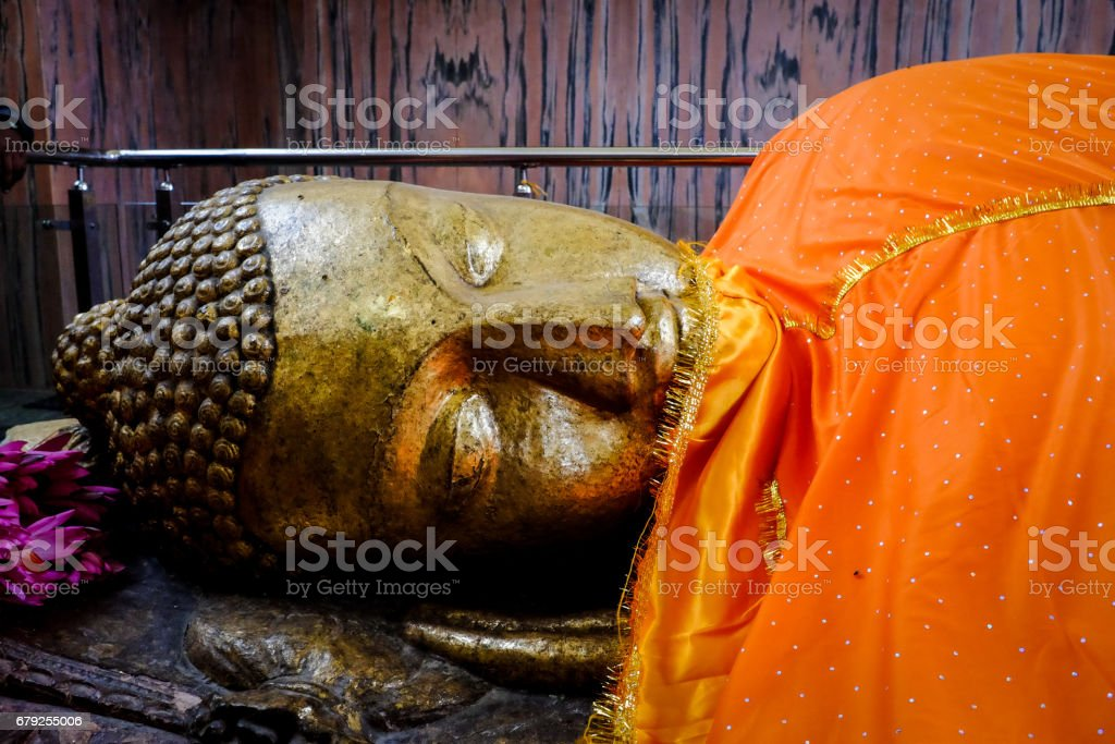Reclining Buddha Statue at Parinirvana Temple in Kushinagar, India. stock photo