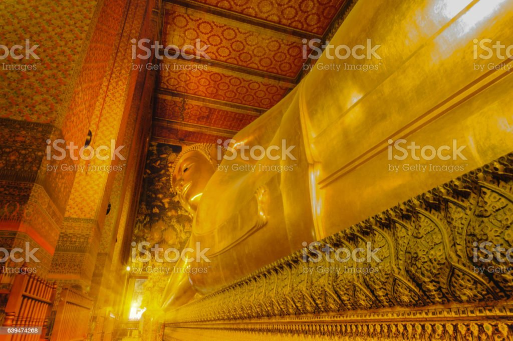 Reclining golden Buddha statue stock photo