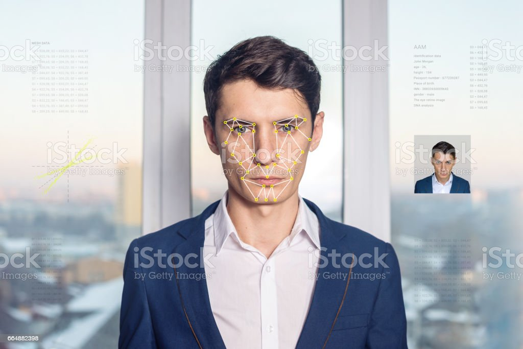Recognition of male face. Biometric verification and identification stock photo