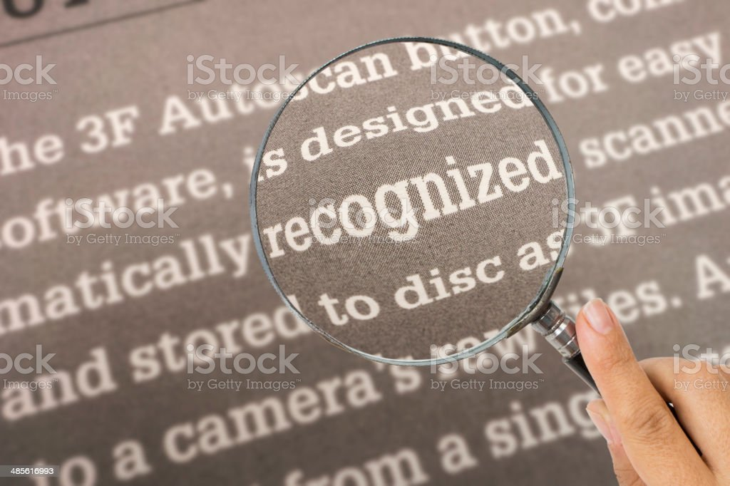 Recognized , with Magnifying Glass stock photo