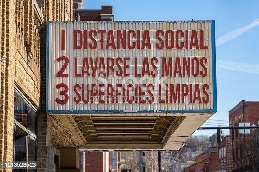 istock Recommendations for avoiding Coronavirus on cinema board in Spanish language 1213528523