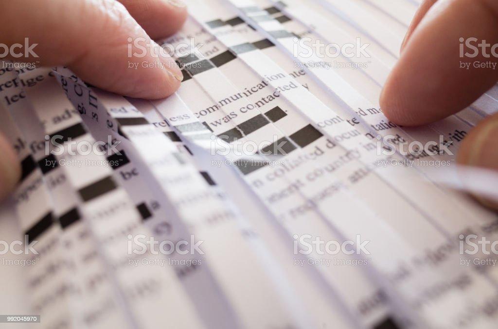 Reconstructing Shredded Redacted Document stock photo