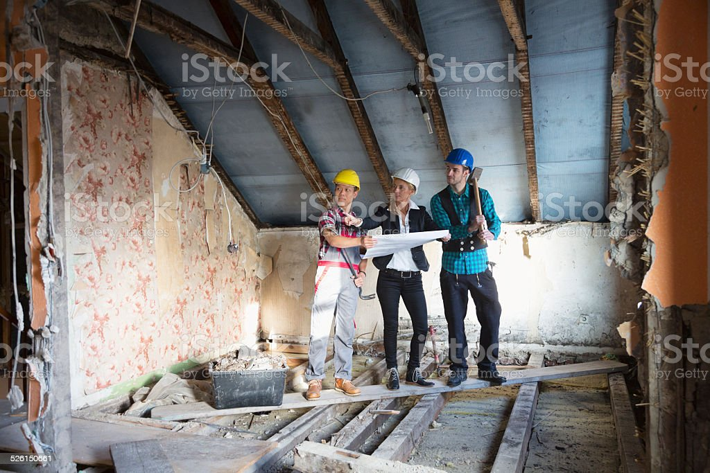 reconstruction old house architect and construction worker stock photo