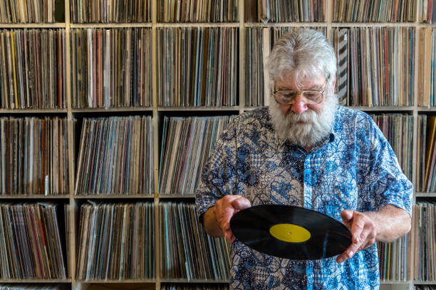 Record collector in front of his collection stock photo
