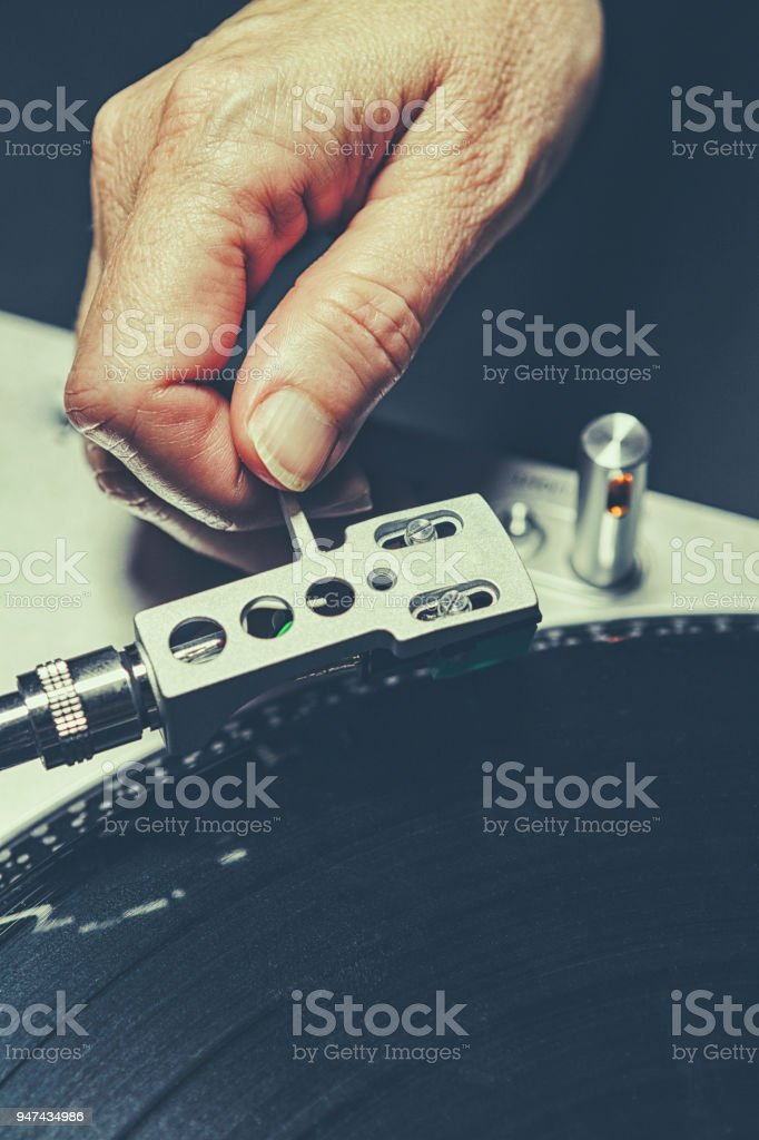 Record Player and Woman's Hand stock photo