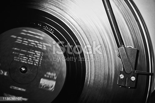 Motion Blur Record on Turntable with light reflecting off spinning record. Black&White
