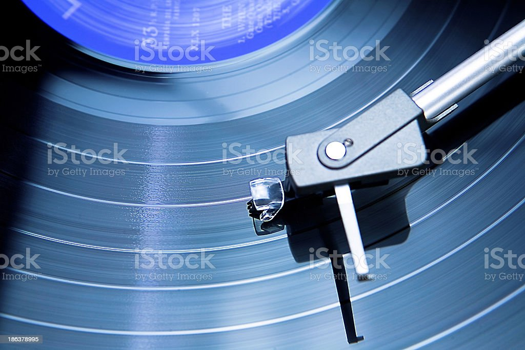 Record playing on turntable royalty-free stock photo