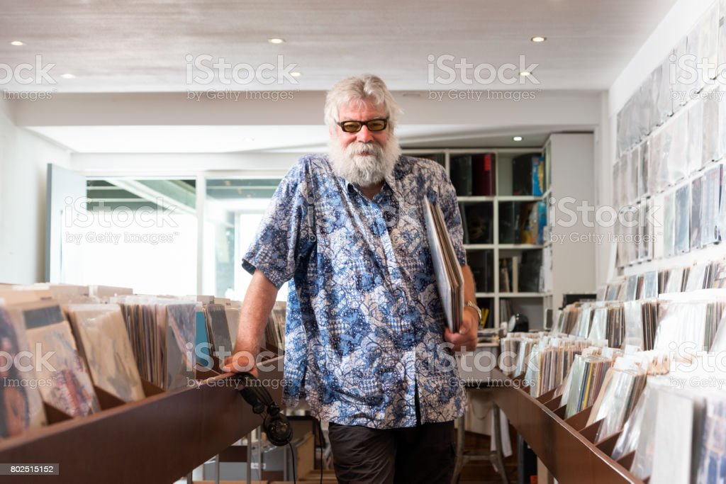 Record store owner in  his shop stock photo