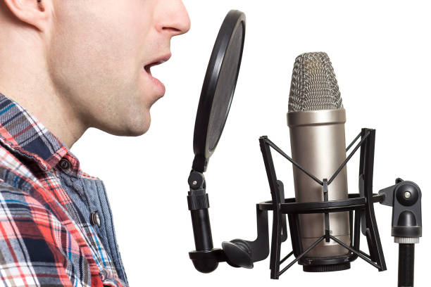 record voice to microphone in studio. young man sings in studio condenser microphone with spider isolated on white background. write song in sound recording studio. - radio dj stock photos and pictures