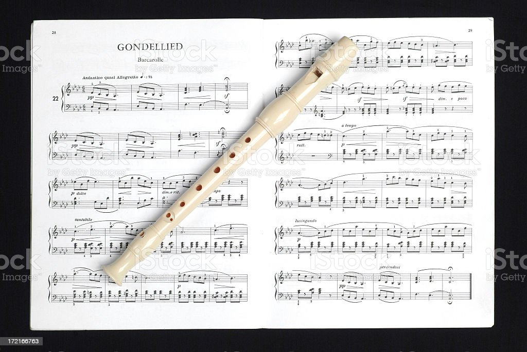 Recorder (flute) on sheet music royalty-free stock photo