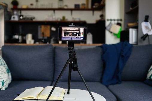 Recording equipment in living room and kitchen for home video blog. set up