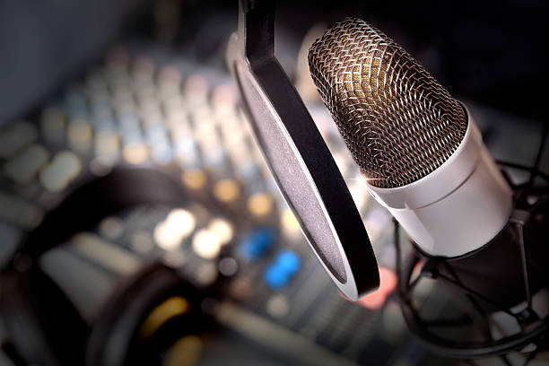 Recording equipment in studio Recording equipment in studio. Studio microphone with headphones and mixer background. Elevated view radio dj stock pictures, royalty-free photos & images