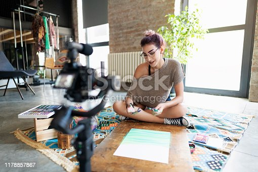 1179265329 istock photo Recording new vlog lesson for her followers 1178857867