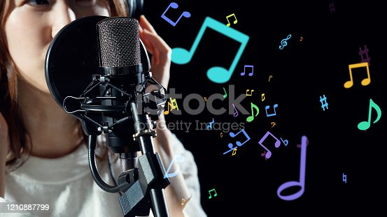 478117515 istock photo Recording of song concept. Young female asian singer. 1210887799