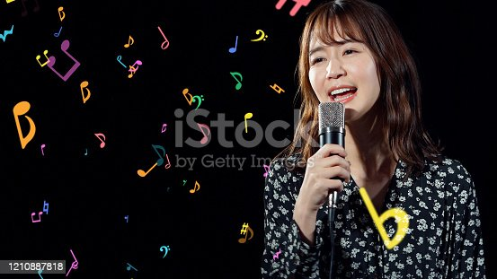 478117515 istock photo Recording of song concept. Young female asian singer. 1210887818