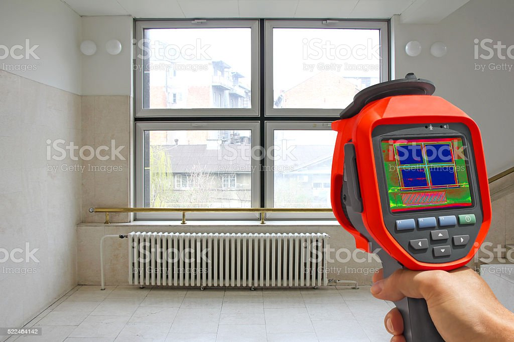 Recording Radiator and a window on a building with Thermal Camera stock photo