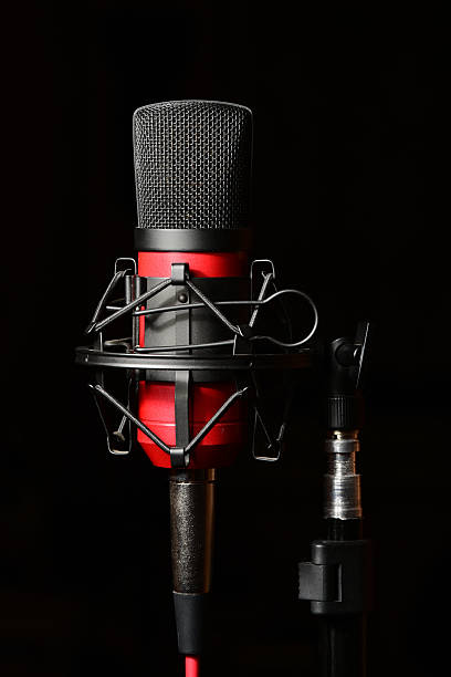 recording studio red microphone with shock mount - stay tuned bildbanksfoton och bilder