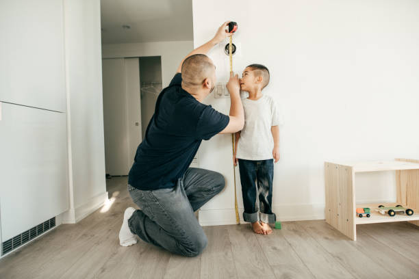 recording the height of a boy - height measurement stock photos and pictures