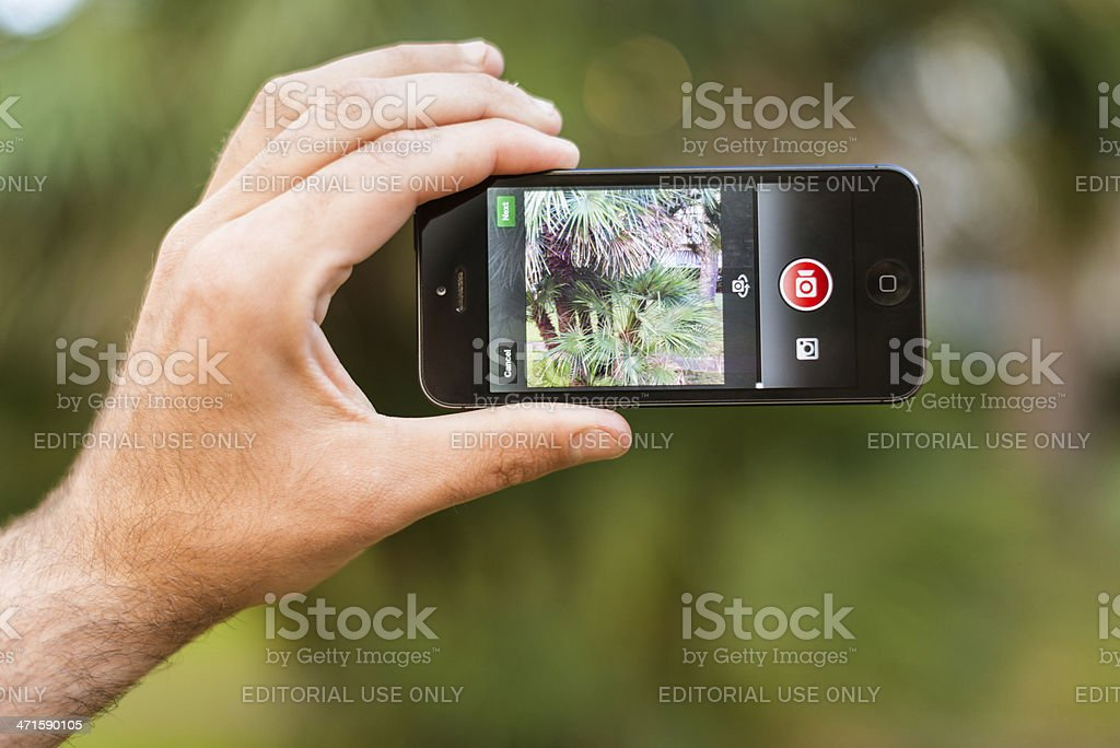 recording video with instagram app on iphone 5 royalty-free stock photo